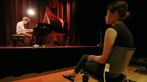 Pianist Elliot Galvin performs to a limited audience during the launch of Kings Place London's one-on-one Culture Clinics, where solo spectators watch from a safe social distance (Jonathan Brady/PA)
