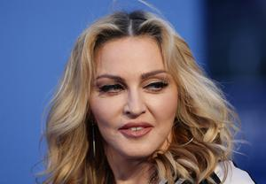 An ivory gown worn by Madonna was also sold (Yui Mok/PA)
