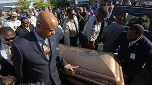 The coffin bearing the body of blues legend BB King is wheeled to a waiting hearse (AP)