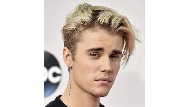Justin Bieber has revealed he has been diagnosed with Lyme disease (AP Photo by Jordan Strauss/Invision/AP)
