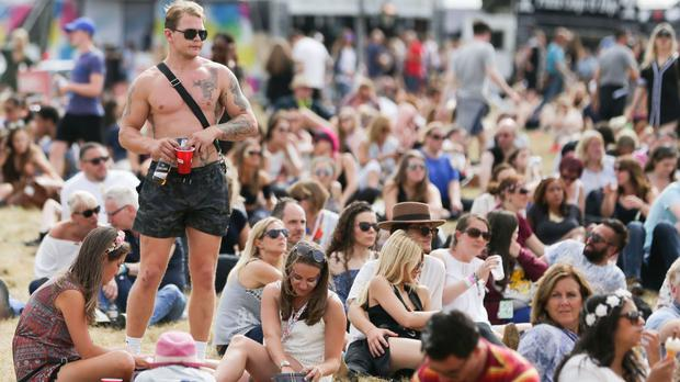 Festival goers enjoy the weather in Chelmsford, Essex