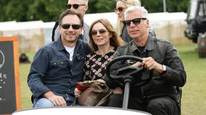 Festival Organiser John Giddings (right) driving Geri Halliwell and her husband Christian Horner (front left), and Ronan Keating (back left) and girlfriend Storm Uechtritz (back right) backstage at the Isle of Wight Festival