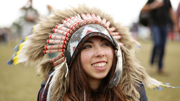 Latisha Anongu, 20, from Portsmouth, relaxes at the Isle of Wight Festival