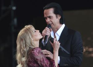 Kylie Minogue performing with Nick Cave at the festival (Yui Mok/PA)