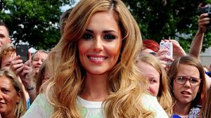 Cheryl Fernandez-Versini says she wouldn't sign under-18s to her own label