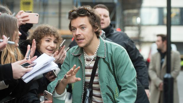 Harry Styles speaks with fans as he leaves Wogan House in London after an appearance on Radio 2's The Zoe Ball Breakfast Show (David Mirzoeff/PA)
