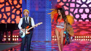 Ed Sheeran performs on the catwalk during the Victoria's Secret fashion show at Earls Court