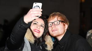 Ed Sheeran poses with fans outside the BBC