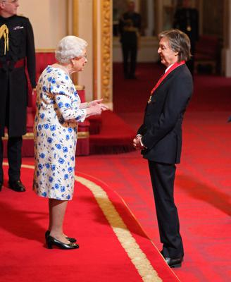 Twenty years after being knighted, the Queen made Sir Paul a Companion of Honour. He paid tribute to his parents after receiving the award (Yui Mok/PA)