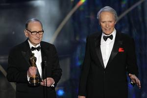 Morricone, left, accepts an honorary Oscar for his contributions to the art of film music as director Clint Eastwood looks on at the 79th Academy Awards (AP)