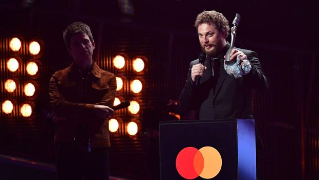 Duncan Jones accepts an award on behalf of his father, David Bowie, at the Brit Awards in London