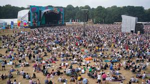 Festivalgoers watch Bill Bailey perform at Latitude Festival (Jacob King/PA)