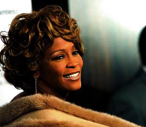 File photo of Whitney Houston attending the Clive Davis pre-Grammy party in Beverly Hills...Whitney Houston attends the Clive Davis pre-Grammy party in Beverly Hills, California in this February 10, 2007 file photo. Houston died of accidental drowning due to the effects of cocaine use and heart disease, a Los Angeles County coroner's spokesman said on March 22, 2012. REUTERS/Mario Anzuoni/Files  (UNITED STATES - Tags: ENTERTAINMENT PROFILE HEADSHOT)...E