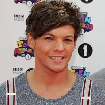 Louis Tomlinson has urged One Direction fans to buy their Comic Relief single