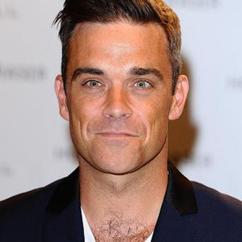 Robbie Williams has been in the studio with Guy Chambers