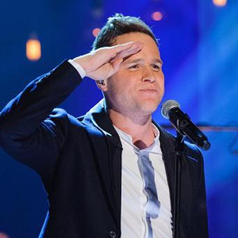 Olly Murs is supporting Robbie Williams on his stadium tour