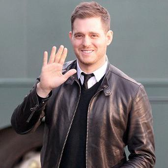 Michael Buble and his wife are expecting their first baby