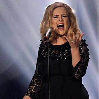 Adele is queen of the download chart with her massive hit Someone Like You
