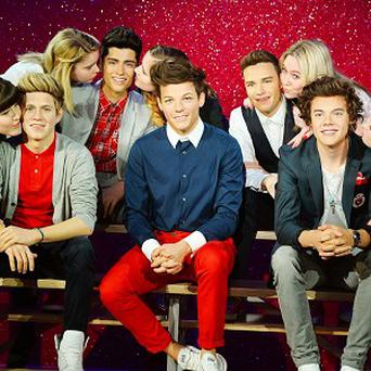 Fans met waxwork versions of One Direction