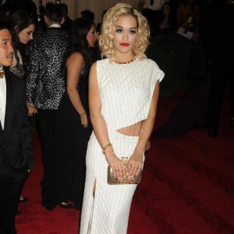 Rita Ora is apparently dating Calvin Harris
