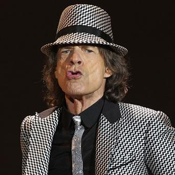 Mick Jagger has been praised by Bono for having a beautiful face