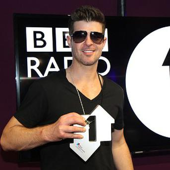 Robin Thicke accepts his Official Number 1 Award for Blurred Lines (BBC/PA Wire)