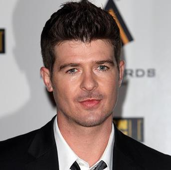 Robin Thicke doesn't mind comparisons to Justin Timberlake