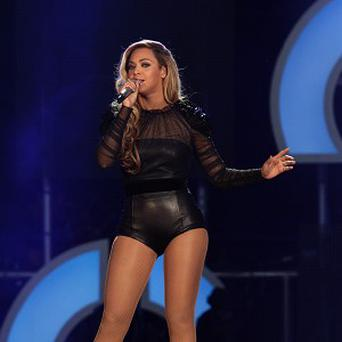 Beyonce has settled the lawsuit with the game company