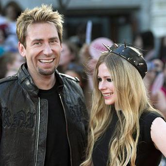 Avril Lavigne is now happily engaged to Chad Kroeger and says she doesn't sing break-up songs any more
