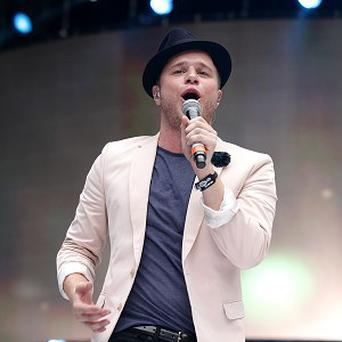 Olly Murs said performing with Robbie Williams is 'a thrill'