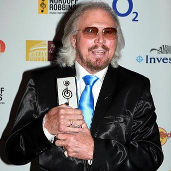 Barry Gibb accepted a lifetime achievement gong at the Nordoff Robbins O2 Silver Clef Awards