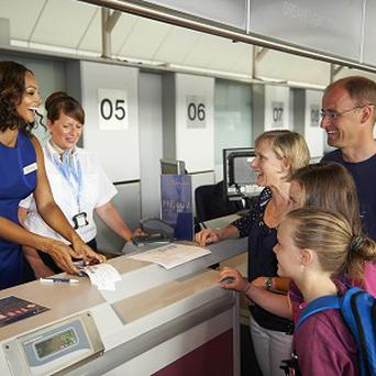 Alesha Dixon helps check in the Watt family on their way to Orlando