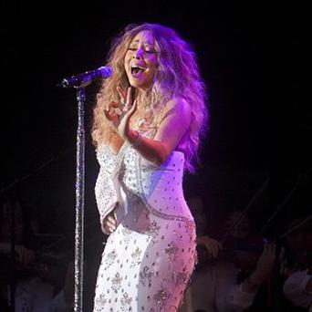 Mariah Carey performs in Central Park, New York, during a charity concert (AP)