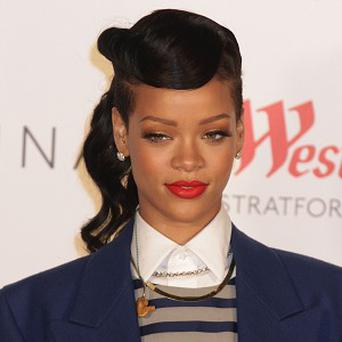 Rihanna is fighting a legal battle over her image being used on a top
