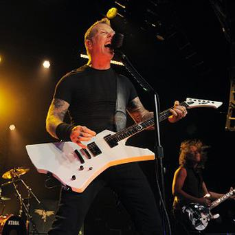 Lars Ulrich, left, James Hetfield and Kirk Hammett of Metallica perform at the Comic-Con International Convention (Chris Pizzello/Invision/AP)