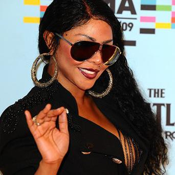 Lil Kim has said sorry for not performing at Lovebox
