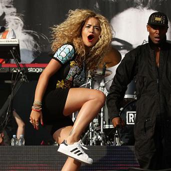 Rita Ora uses Jay Z's work ethic as an example