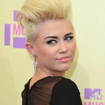 Miley Cyrus is suffering from food poisoning