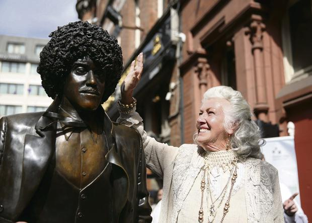Philomena Lynott unveils the repaired statue on Harry Street Dublin