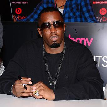 Diddy has denied claims he had a fight with rapper J Cole