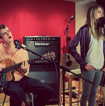 Will Heard and Cara Delevingne singing