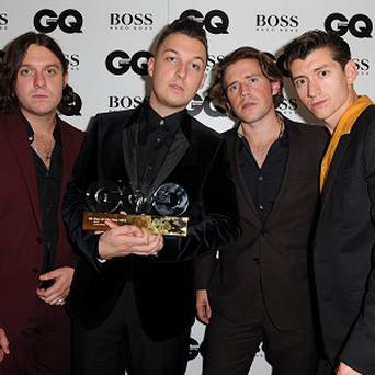 Arctic Monkeys scored their fifth consecutive number one album with AM
