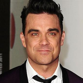Robbie Williams' new album will be out the week before Gary Barlow's latest solo venture