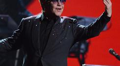 Sir Elton John was fiery on his red piano, belting out tunes including Tiny Dancer and Bennie And The Jets (Al Powers/Powers Imagery/Invision/AP)