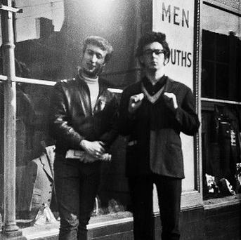 John Lennon and Paul McCartney posing on the streets of Liverpool before fame and moptop hairstyles took hold