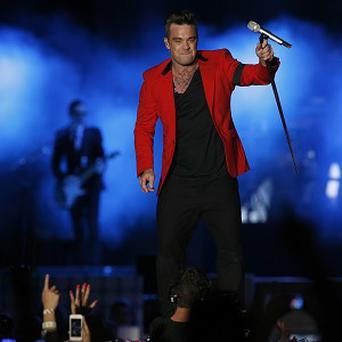 Robbie Williams will launch his new album of swing songs with a gig at the London Palladium