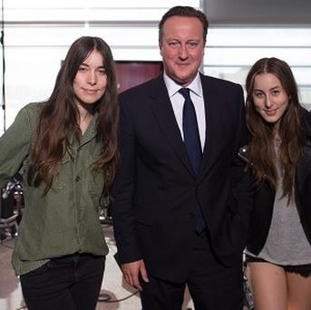 Prime Minister David Cameron with rock band Haim, who have gone to the top of the album charts