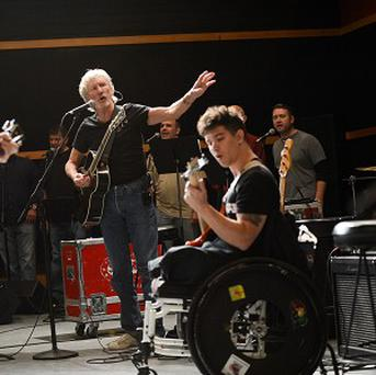 Roger Waters, center, holds rehearsals with members of the Wounded Warriors Project ahead of the Stand Up For Heroes benefit concert in New York (AP)