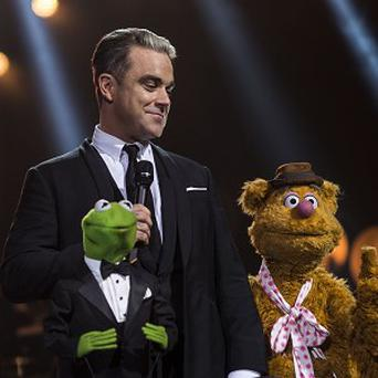 Robbie Williams unveils his forthcoming album, Swings Both Ways, at the London Palladium