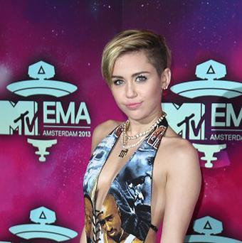 Miley Cyrus arrives at the 2013 MTV Europe Music Awards (AP)